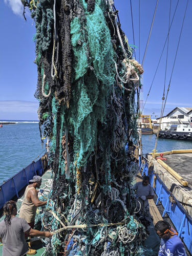 This photo taken June 18, 2019, provided by the Ocean Voyages Institute, shows a large net that was removed from the ocean during the Pacific gyre cleanup in Honolulu. (Greg Yoder/Ocean Voyages Institute via AP)