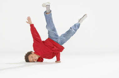 Young boy break dancing