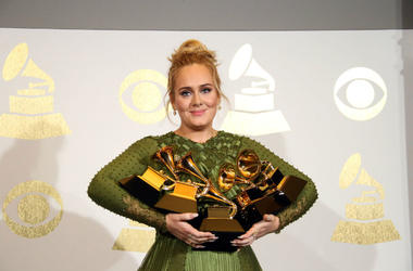 Adele holding all of her Grammys