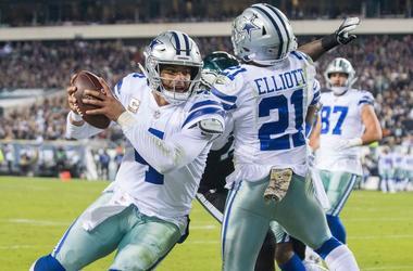 Cowboys quarterback Dak Prescott (4) carries the ball just shy of the goal line against the Eagles, alongside Zeke Elliot (21)