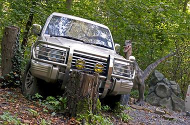 Dinosaur and a broken down car