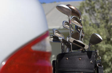 Golf Clubs by a car