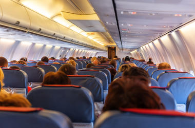 Interior of airplane with passengers in seats