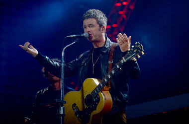 Noel Gallagher performs on stage