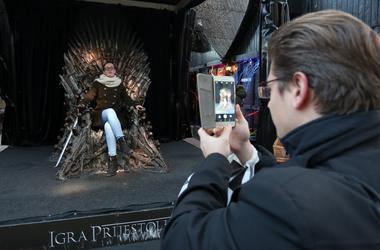 taking a photo with the iron throne