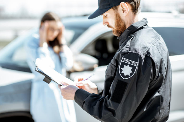 Police issuing a ticket to a woman