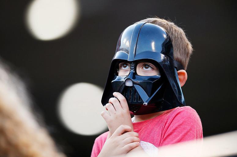 Kid in a Darth Vader mask
