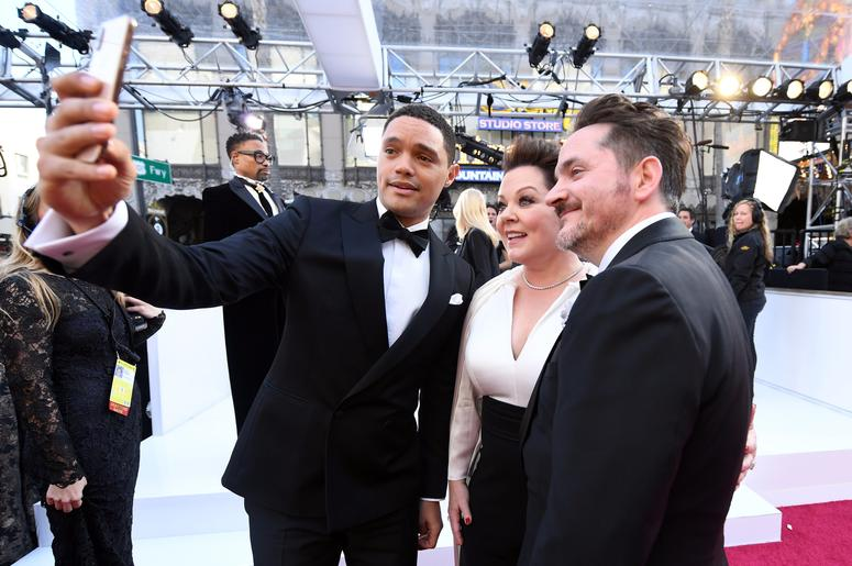 Trevor Noah, Melissa McCarthy and Ben Falcone