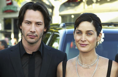 "LOS ANGELES - MAY 7: Cast members Keanu Reeves (L), Carrie-Anne Moss and Hugo Weaving (pictured) arrive at the premiere of ""The Matrix Reloaded"" at the Village Theater on May 7, 2003 in Los Angeles, California. (Photo by Kevin Winter/Getty Images)"
