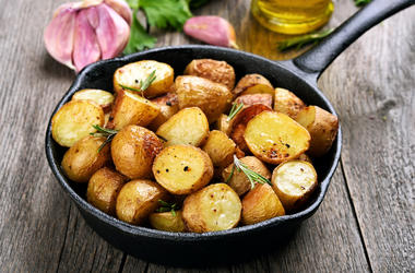 Roasted potato in frying pan - Roasted potato in frying pan on wooden background