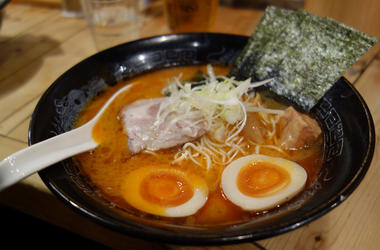 Candid shot of authentic Japanese ramen noodles in black bowl - Real, unposed shot of authentic ramen noodles in a black bowl, taken at a Japanese Restaurant. Complete with egg, noodles seaweed and ramen spoon in a tasty broth. (Photo credit: Getty Images