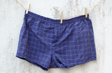 Blue boxer underwear on grunge wall (Photo credit: Getty Images)