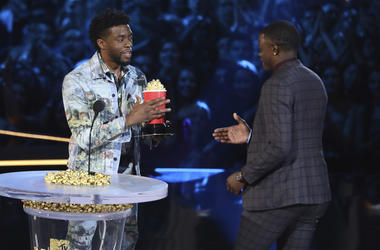 """Chadwick Boseman, left, gives his best hero award for his role in """"Black Panther"""" to James Shaw Jr."""