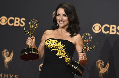 """In this Sunday, Sept. 17, 2017 file photo, Julia Louis-Dreyfus poses in the press room with her awards for outstanding lead actress in a comedy series and outstanding comedy series for """"Veep"""" at the 69th Primetime Emmy Awards at the Microsoft Theater in L"""