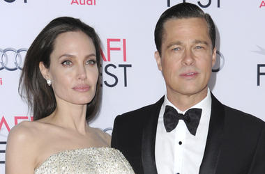 """In this Nov. 5, 2015 file photo, Angelina Jolie, left, and Brad Pitt arrive at the 2015 AFI Fest opening night premiere of """"By The Sea"""" in Los Angeles. (Photo by Richard Shotwell/Invision/AP, File)"""