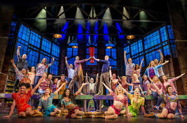 """This image released by Fathom Events shows the cast during a performance of the musical """"Kinky Boots.""""  (Matt Crockett/Fathom Events via AP)"""