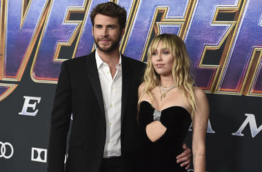 """In this Monday, April 22, 2019, file photo, Liam Hemsworth, left, and Miley Cyrus arrive at the premiere of """"Avengers: Endgame"""" at the Los Angeles Convention Center. (Photo by Jordan Strauss/Invision/AP, File)"""