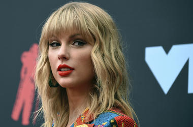 In this Aug. 26, 2019 file photo, Taylor Swift arrives at the MTV Video Music Awards in Newark, N.J.  (Photo by Evan Agostini/Invision/AP, File)