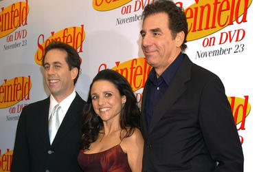 In this Nov. 17, 2004, file photo Jerry Seinfeld, left, Julia Louis Dreyfus and Michael Richards arrive to celebrate the release of the first three seasons of Seinfeld on DVD in New York. (AP Photo/ Louis Lanzano, File)