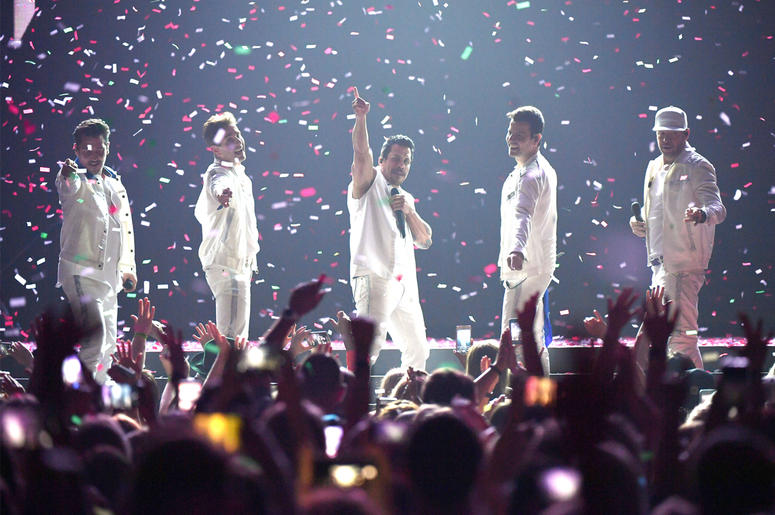 NASHVILLE, TENNESSEE - MAY 09: Jonathan Knight, Joey McIntyre, Danny Wood, Jordan Knight and Donnie Wahlberg of the musical group New Kids On The Block perform at Bridgestone Arena on May 09, 2019 in Nashville, Tennessee. (Photo by Jason Kempin/Getty Imag