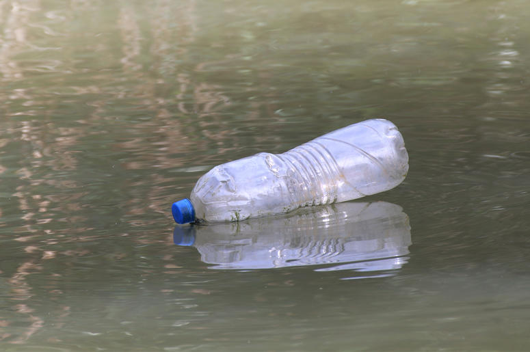 Plastic Bottle Waste On the water surface dirty, Rotten water, Bottle Waste (Photo credit: Amnat Buakeaw)