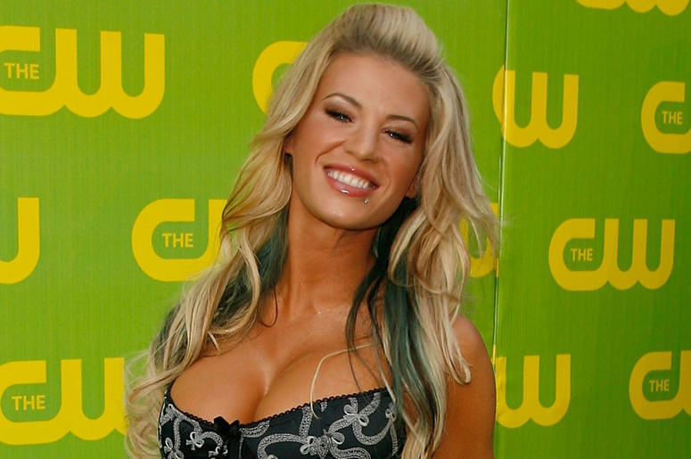 BURBANK, CA - SEPTEMBER 18: TV personality Ashley Massaro arrives at the CW Launch Party at the Warner Bros. Studio on September 18, 2006 in Burbank, California. (Photo by Kevin Winter/Getty Images)