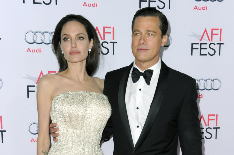 "In this Nov. 5, 2015 file photo, Angelina Jolie, left, and Brad Pitt arrive at the 2015 AFI Fest opening night premiere of ""By The Sea"" in Los Angeles. Jolie Pitt says she wants her divorce from Brad Pitt finalized before the end of the year, and that she"