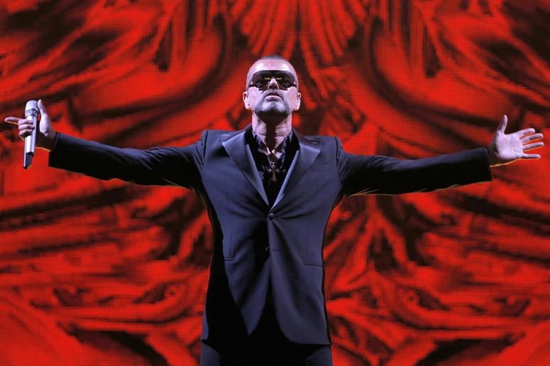 In this Sept. 9, 2012 file photo, British singer George Michael performs at a concert to raise money for the AIDS charity Sidaction, during the Symphonica tour at Palais Garnier Opera house in Paris, France. Artworks collected by George Michael before his