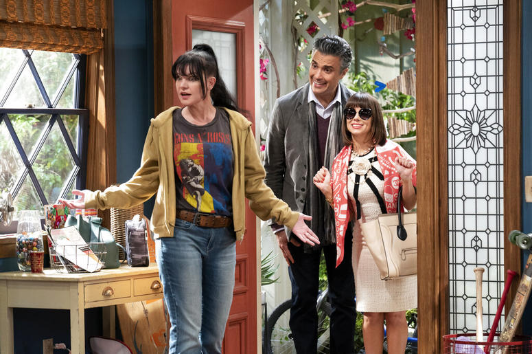 "Pauley Perrette, Jaime Camil and Natasha Leggero in a scene from the sitcom ""Broke."""