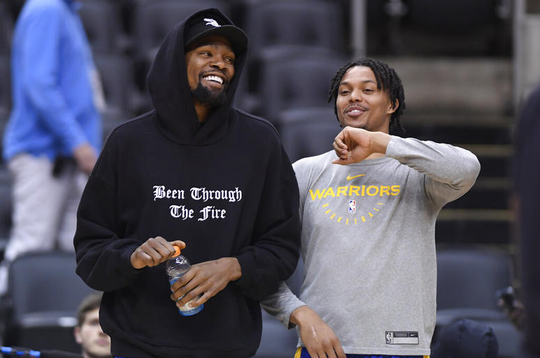 Golden State Warriors Kevin Durant laughs with teammate Damion Lee