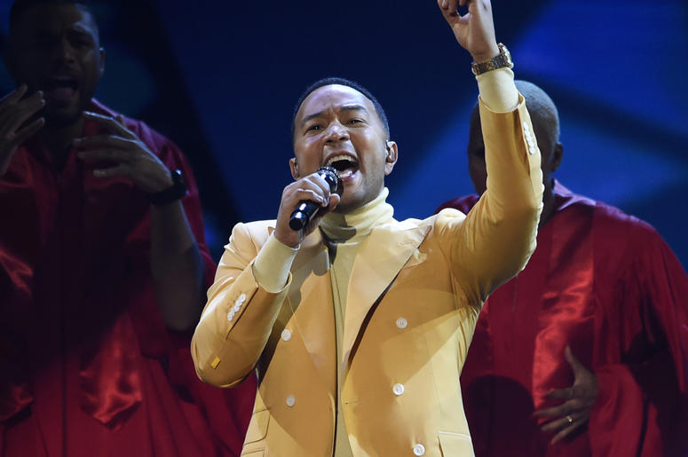"""In this March 14, 2019, file photo, John Legend performs """"Preach"""" at the iHeartRadio Music Awards at the Microsoft Theater in Los Angeles. (Chris Pizzello/Invision/AP, File)"""