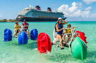 Family has fun in the ocean while on the Disney Dream cruise