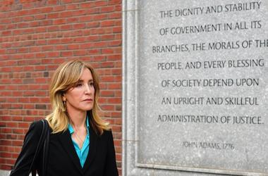 BOSTON, MA - APRIL 03: Felicity Huffman exits the John Joseph Moakley U.S. Courthouse after appearing in Federal Court to answer charges stemming from college admissions scandal on April 3, 2019 in Boston, Massachusetts.