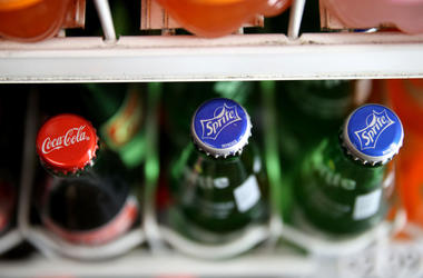 Coca-Cola and Sprite bottles on the shelf