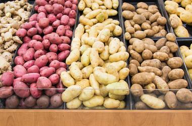 Bin of potatoes at super market
