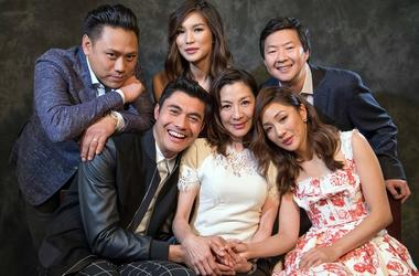 """Aug 5, 2018; Beverly Hills, CA, USA; Portrait of the director and cast of \""""Crazy Rich Asians.\"""" (From left to right) Director Jon M Chu, Henry Golding, Gemma Chan, Michelle Yeoh, Constance Wu and Ken Jeong. The film is an adaptation of the best selling b"""