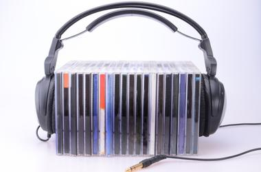 Headphones with stack of CDs