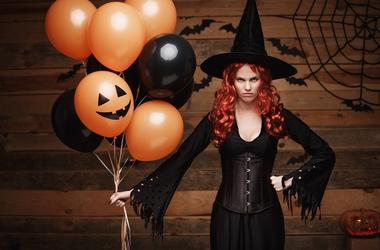 halloween costumes Photos    Halloween Witch Concept - Beautiful caucasian woman in witch costumes celebrating Halloween posing with posing with orange and bla. Jack, isolated.