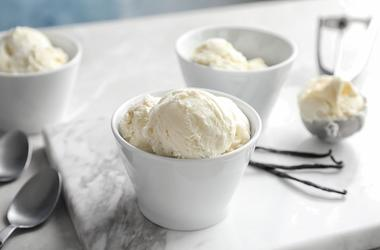 Bowls with tasty vanilla ice cream.