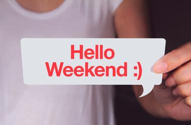 Hand holding white talk bubble and showing hello weekend wording