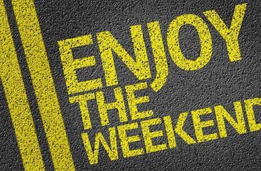 Happy Enjoy the Weekend written on the road