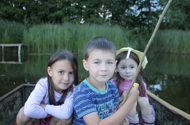 Portrait of three children fishing