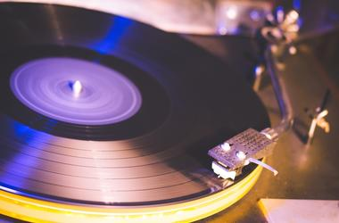 Close up at vintage gramophone. playing old song,Vintage record player with vinyl disc. Object, music.