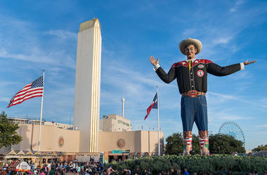 Big Text overlooking crowd at State Fair of Texas