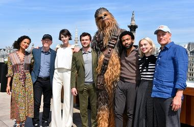 5/18/2018 - Star Wars cast and crew (left to right) Thandie Newton, Ron Howard, Phoebe Waller-Bridge, Alden Ehrenreich, Chewbacca, Donald Glover, Emilia Clarke and Woody Harrelson attending the photocall for Solo: A Star Wars Story at The Trafalgar St. Ja