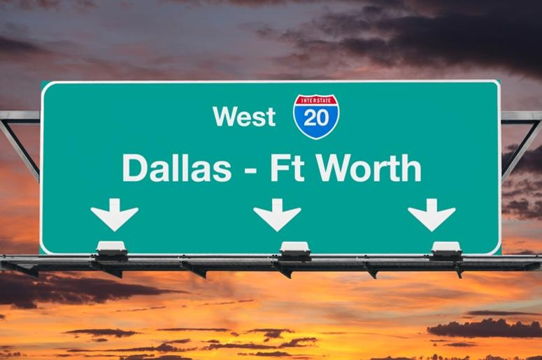 Dallas Ft Worth Interstate 20 west highway sign with sunrise sky.