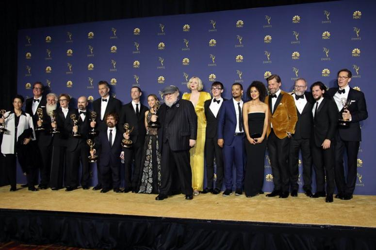"""Sep 17, 2018; Los Angeles, CA, USA; The cast and crew of """"Game of Thrones\"""" pose with their awards for Drama Series in the photo room during the 70th Emmy Awards at the Microsoft Theater"""