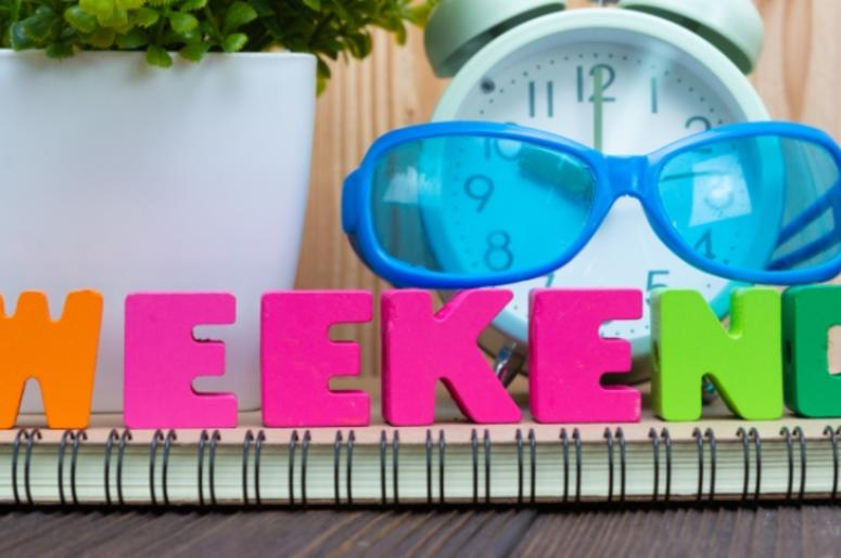 WEEKEND letters text and notebook paper, alarm clock and little