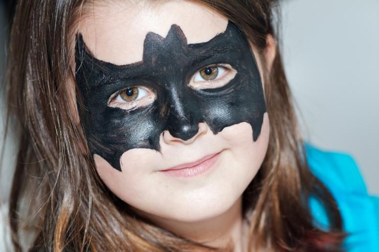 Child with bat face painting