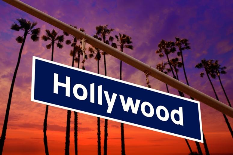 Hollywood California road sign on redlight with pam trees photo. Summer, beautiful.